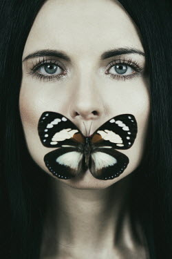 Magdalena Russocka close up of woman with butterfly on mouth