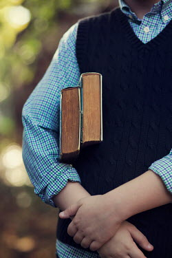 Kelly Sillaste Mid section of boy holding books