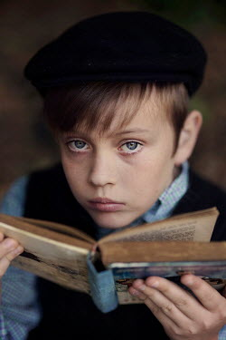 Kelly Sillaste Boy with beret holding open book
