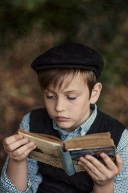 Kelly Sillaste Boy with beret reading in forest