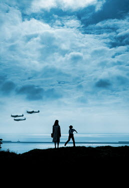Stephen Mulcahey silhouettes of a mother and son looking at planes flying  overhead