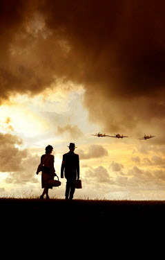 Stephen Mulcahey silhouettes of ww2, couple looking at planes flying  overhead