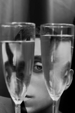 Michelle De Rose Young man behind wine glasses