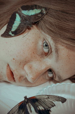 Michelle De Rose Teenage girl with freckles and butterflies