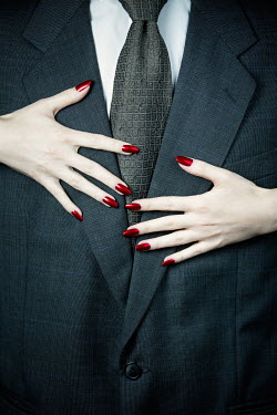 Magdalena Russocka FEMALE HANDS TOUCHING CHEST OF MAN IN SUIT Couples