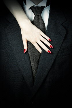 Magdalena Russocka woman's hand on torso of man in suit