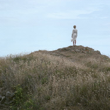 Dmytro Baidachnyi Woman in white dress standing on hill Women