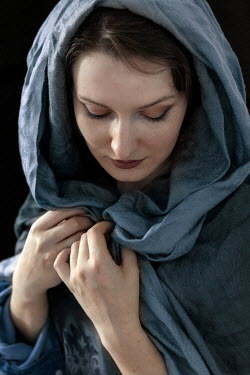Jaroslaw Blaminsky CLOSE UP OF HISTORICAL WOMAN IN BLUE SCARF Women