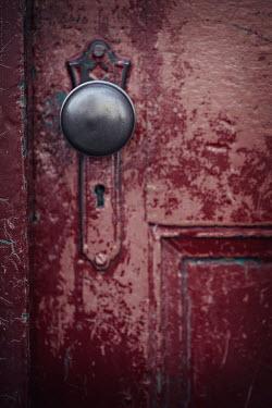 Jaime Brandel Close up of door knob on red door Building Detail
