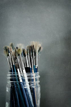 Jaime Brandel Worn paint brushes in jar