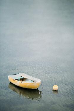 Jaime Brandel Yellow boat moored in sea