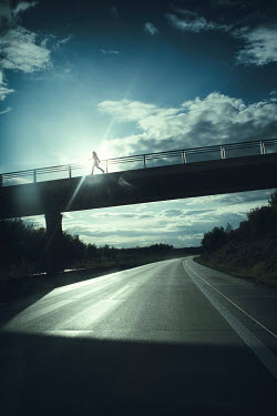 Magdalena Russocka modern woman running on bridge over motorway