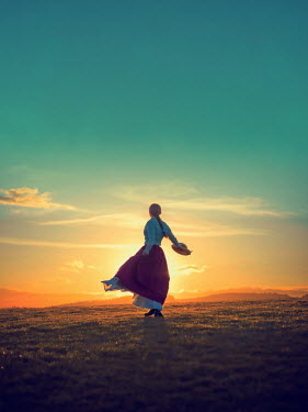Mary Wethey HISTORICAL WOMAN DANCING IN FIELD AT SUNSET Women