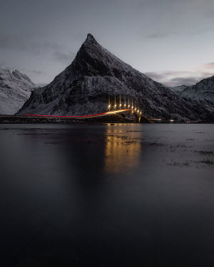 Paul Sheen Light trails on coastal highway by mountain in Norway