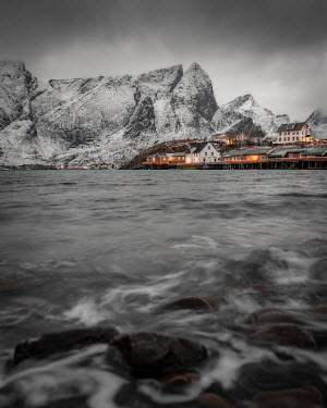Paul Sheen Fishing village by mountain in Norway