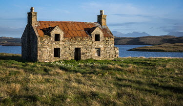Rodney Harvey Weathered stone cottage by river