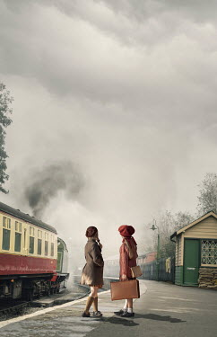 CollaborationJS Two  evacuee girls waiting at a train station Children