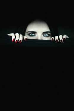 Magdalena Russocka woman behind black curtain staring