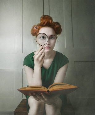 Anna Buczek Young woman with hair rollers, magnifying glass, and book