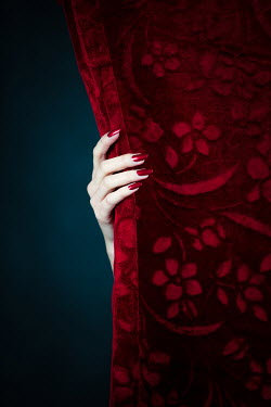Magdalena Russocka hand of elegant woman reveal red curtain