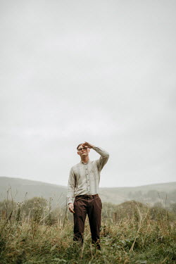 Shelley Richmond Young man with glasses shielding his eyes in field