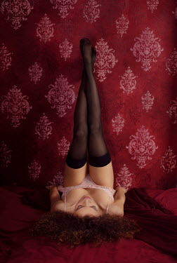 Alex Maxim WOMAN IN STOCKINGS  LYING AGAINST WALL