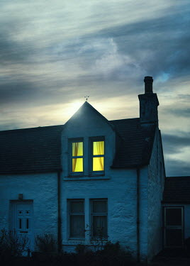 Magdalena Russocka light in window of cottage house at dusk