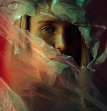 Kirill Sakryukin WOMAN STARING THROUGH HOLE IN PLASTIC Women