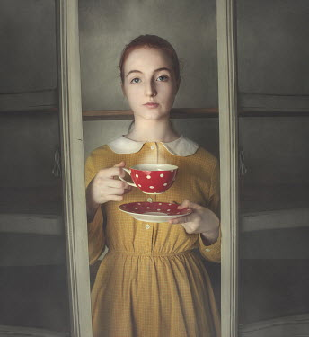 Anna Buczek GIRL IN CUPBOARD HOLDING CUP AND SAUCER Women
