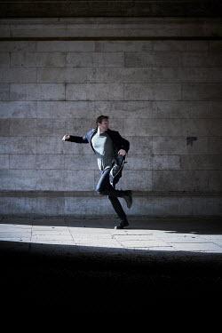 CollaborationJS A man running  along a subway Men