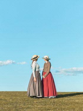 Mary Wethey TWO HISTORICAL WOMEN IN FIELD IN SUMMER Women