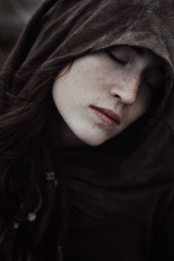 Charlotte Grimm Hooded young woman with her eyes closed