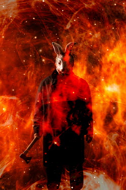Valentino Sani Double exposure of man in rabbit mask with axe and flames