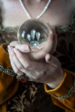 Jaroslaw Blaminsky HISTORICAL WOMAN HOLDING GLASS BALL Women