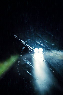 Magdalena Russocka car's headlights on road through wet windscreen at night