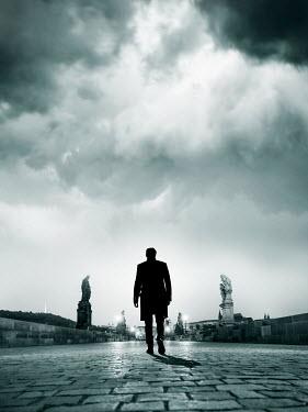 CollaborationJS A man walking across the Charles Bridge