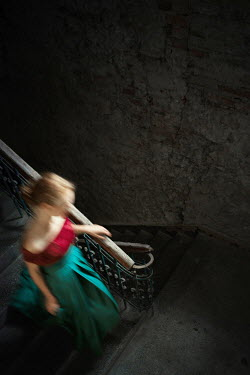 Magdalena Russocka historical woman walking down stairs in old building