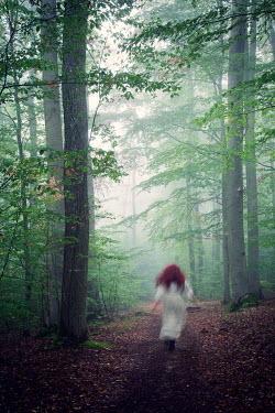 Carmen Spitznagel Blurred woman walking in forest