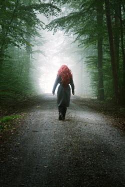 Carmen Spitznagel Woman walking on trail in forest