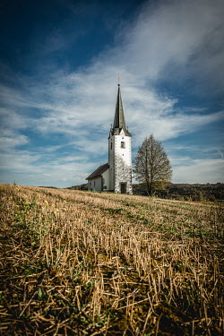 Des Panteva SMALL CHURCH WITH SPIRE IN COUNTRYSIDE Religious Buildings