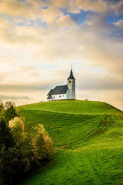 Des Panteva WHITE CHURCH ON HILL IN COUNTRYSIDE Religious Buildings