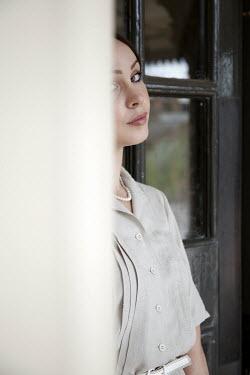 Miguel Sobreira Vintage Woman Standing Against Door