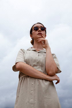 Miguel Sobreira Vintage Woman With Sunglasses Against Sky