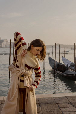 Elisa Paci Young woman by water in Venice, Italy