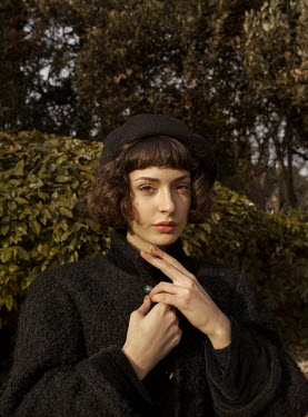 Elisa Paci Young woman in black coat and beret