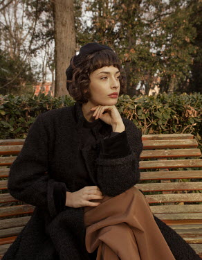 Elisa Paci Young woman sitting on park bench