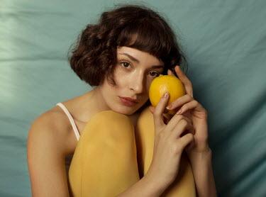 Elisa Paci Young woman holding orange