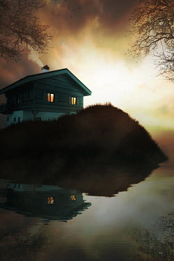 Ildiko Neer House by lake at evening