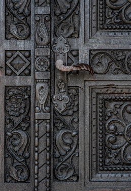 Jaroslaw Blaminsky CLOSE UP OF DECORATIVE DOOR AND HANDLE Building Detail