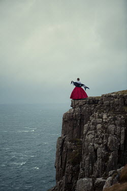 Magdalena Russocka historical woman standing on cliff